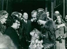 Queen Paola of Belgium and Albert II of Belgium talking with women.