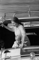 Princess Anne in boat with child.