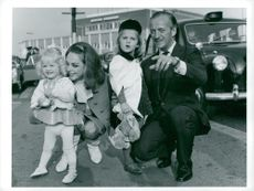 David Niven with Mrs Hjördis and their daughters in London