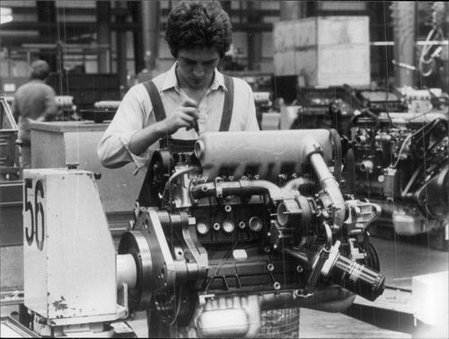 A worker is doing the final work on a diesel engine for Volkswagen LT at the VW factory in Salzgitter