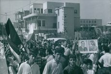 Lebanese people is showing their objection during 1958 Lebanon crisis, while some of them hold picture of Egyptian president Gamal Abdel Nasser