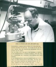 Israeli Doctor Prof. Leo Sachs checking things out with a microscope.