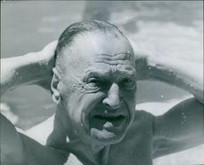 William Somerset Maugham taking a dip in the water.