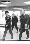 Prince Bernhard of the Netherlands walking with Joseph Marie Antoine Hubert Luns