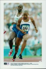 Darren Campbell and Darren Braithwaite run the last bite during the Olympics.