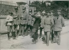 Man pointing his finger towards the front of the soldiers.