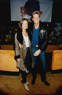 Portrait image of Dolph Lundgren, with unknown lady company, taken on a visit to Planet Hollywood.