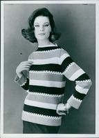 A woman in stripes.