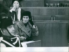 "Women listening someone very carefully during a court proceeding.   "" __ process"""