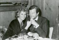 Roger Moore and his wife Luisa have dinner at a charity event at the Palace Hotel