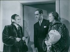 Inga Tidblad, Holger Löwenadler and Irma Christenson in a scene from the film Divorced (Swedish: Frånskild), 1951.