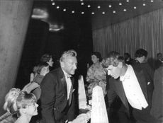 Robert F. Kennedy shaking hand with woman.