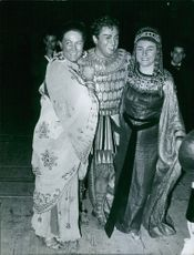 Renata Tebaldi wearing a costume and photographed with other artists. 1959