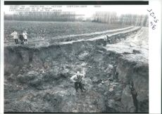 Villagers from Letterhoutem examine the huge hole.