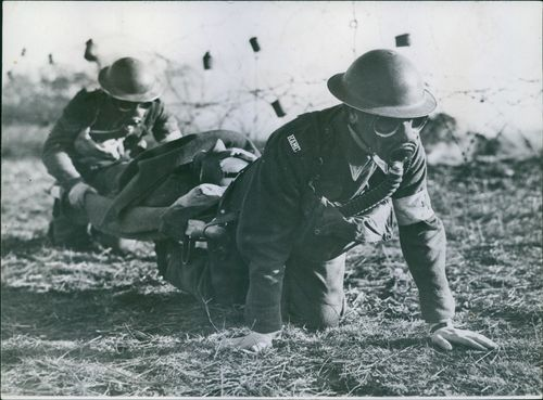 Stretcher bearers are able to crawl while carrying stretcher with wounded thanks to their carrier slings.