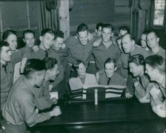 Michele Morgan, playing keyboards infront of the US soldiers. 1941