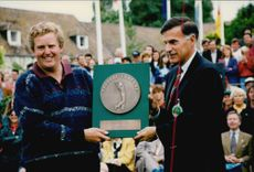 Golf player Colin Montgomerie receives a poster after winning the Lancome Trophy in 1995
