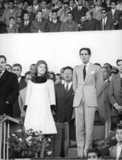 Lamia Solh standing next to her husband Prince Moulay Abdellah of Morocco.