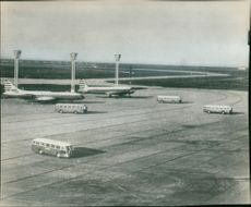 Buses packed on a runway at Orly Airport.