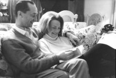 Carlos Hugo and Princess Irene smiling and reading a book together, 1964.
