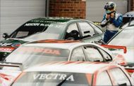 Rickard Rydell leaves his Volvo among the other BTCC cars in the warehouse of Brands Hatch.