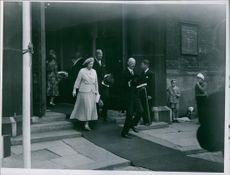 A photo of Princess Alexandra, The Honourable Lady Ogilvy, coming out from building and walking on the carpet.