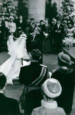 Princess Margriet of the Netherlands and Pieter van Vollenhoven kneeling in church on their wedding day.