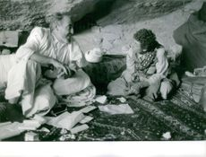 An old man telling a story to a boy, in Yemen, December 1962.