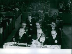 A conference meeting with John Foster Dulles.
