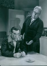"""Sven-Eric Gamble and Adolf Jahr in a scene from a 1950 Swedish drama film, """"While the City Sleeps."""""""