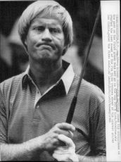 Golf player Jack Nicklaus misses a putt under the PGA