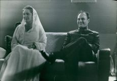 Aly Khan and a woman sitting together.