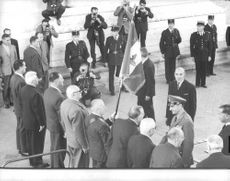 Mohammad Reza Shah Pahlavi greeted by men of the event in Paris