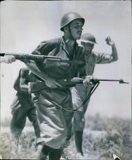 The Royal Corps of Colonial Troops running together in the field,  1942.
