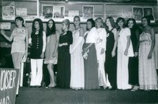 Contestants of a beauty pageant standing in queue.