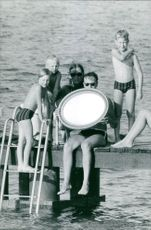 Albert II of Belgium with his family members, after enjoying swimming.