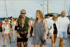 Mickey Rourke with friends during a vacation at the private Onassis Islands.