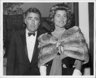 Portrait image of actor Peter Lawford and his wife.