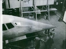 1963 A group of men looking the airplane's design.