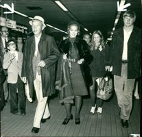 Bing Crosby with his family arriving at heathrow.