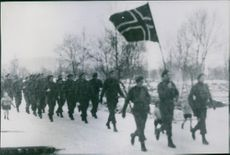 Norwegian soldiers marching with the flag. 1944.