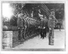 Winston Churchill inspecting military officers.