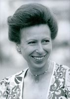 Princess Anne photographed with a beaming smile on her face. 1989.
