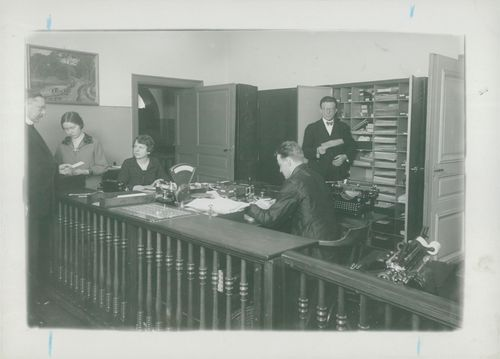 Interior of the stamp collector's counter with notary K. Söderberg in the background
