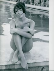 "Christine Barclay sitting by the pool.  ""Barclay, Christine""  1967"