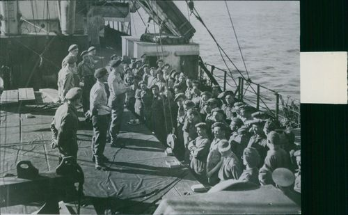 Reviving final instructions aboard a transport before landing somewhere in Holland. 1944