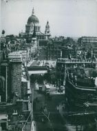 St. Paul's Cathedral still dominates the City of London where gaps in the buildings mark the devastation wrought by Nasi bombs, 1942.