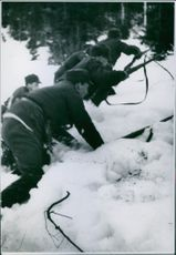 Norwegian soldiers advancing in the field.
