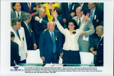 Gianna Angelopoulos rejoices after signing the contract giving Athens the summer 2004. On the left is Juan Antonio Samaranch.
