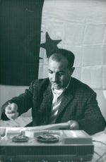 A man reading a document.
